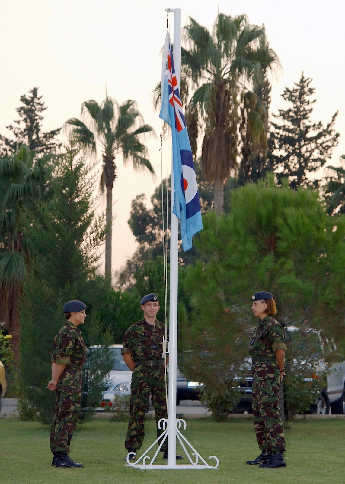 Royal Air Force (RAF), left to right, SENIOR Aircraft Woman Marie Ponton, Corporal (CPL) Ian Barrie and CPL Helen Penny are the Honor Guard for the ceremonial portion of Battle of Britain Observance held at Incirlik Air Base (AB), Turkey, during Operation NORTHERN WATCH