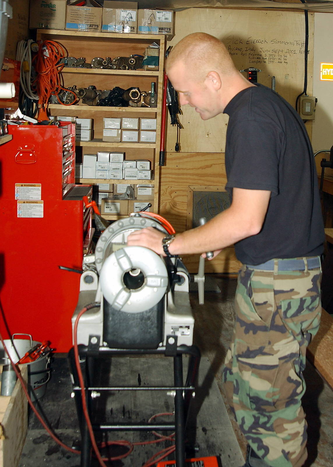 US Air Force (USAF) AIRMAN First Class (A1C) Sean McNeil threads a pipe in the deployed Plumbing shop at Incirlik Air Base, Turkey in support of Operation NORTHERN WATCH