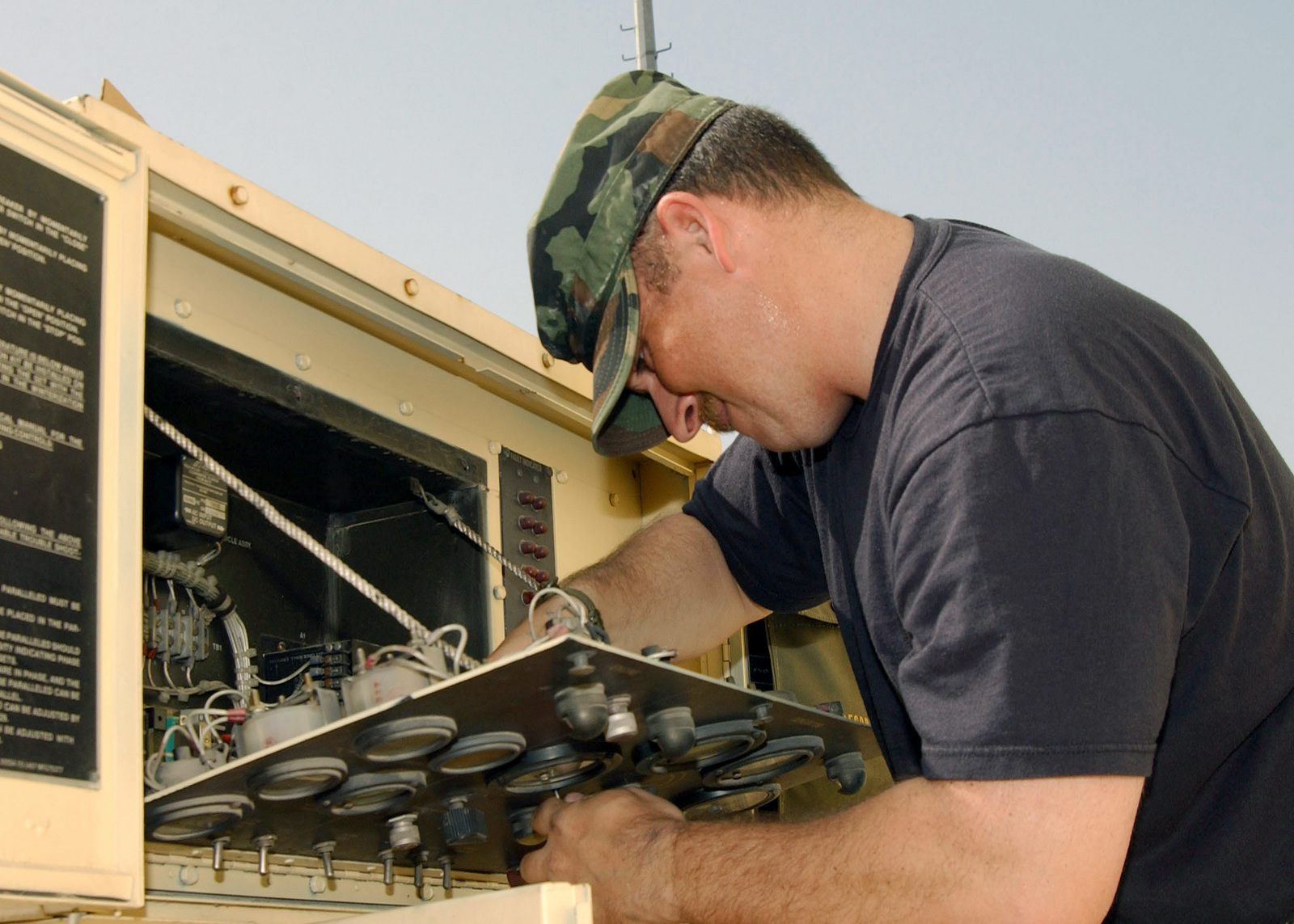 US Air Force (USAF) STAFF Sergeant (SSGT) Frederick Fink, a power production craftsman, repairs the frequency monitoring module on a generator in the deployed power shop at Incirlik Air Base, Turkey in support of Operation NORTHERN WATCH