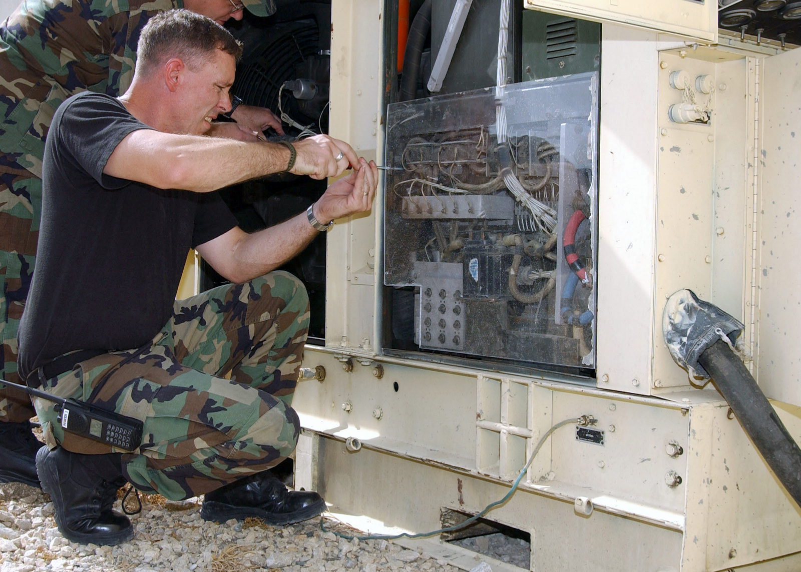 """US Air Force (USAF) Technical Sergeant (TSGT) Michael Harmon, a power production craftsman, works on a generator in the deployed """"power-pro"""" shop at Incirlik Air Base, Turkey in support of Operation NORTHERN WATCH"""
