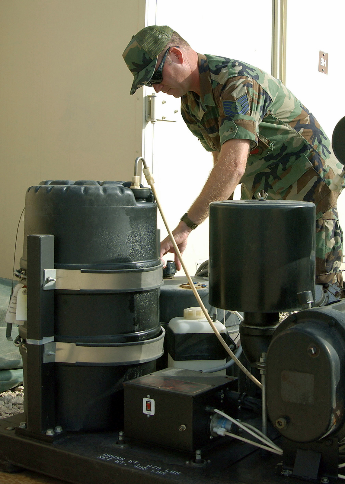 """US Air Force (USAF) Technical Sergeant (TSGT) Tim Clepper, """"Bugman,"""" tends his Ultra Low Volume Mosquito Fogger in the deployed Entomology shop at Incirlik Air Base (AB), Turkey in support of Operation NORTHERN WATCH"""