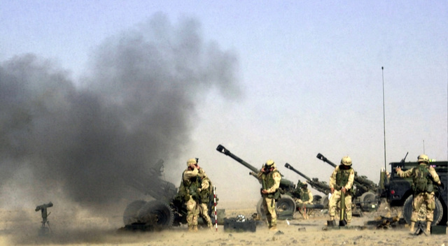 US Army (USA) Soldiers assigned to 1-319th Airborne Field Artillery Regiment, fire their M119A1 105mm Lightweight Towed Howitzers, during live fire exercise held at the artillery range in Kandahar, Afghanistan, during Operation ENDURING FREEDOM
