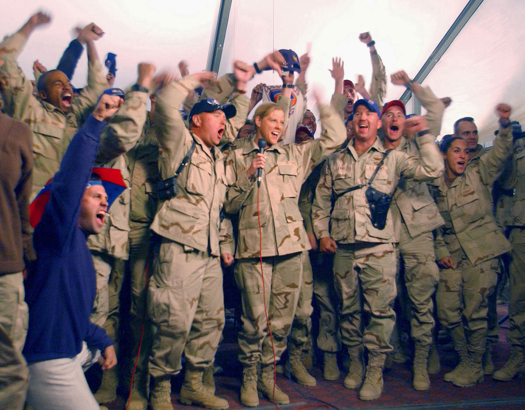 "US Military personnel deployed at Bagram, Afghanistan, enthusiastically kick off the start of the Richmond 500 National Stock Car (NASCAR) auto race, with the phrase ""America, start your engines,"" during a live National Broadcasting Company (NBC) satellite transmission from Afghanistan"