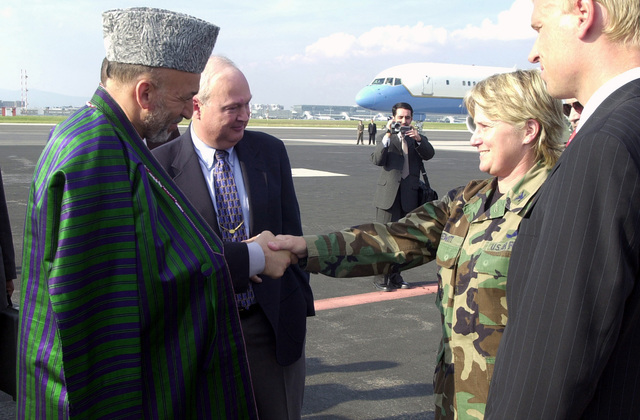During a stopover, Afghan President Hamid Karzai is welcomed to Rhein Main Air Base, Germany by US Air Force (USAF) Colonel (COL) Christine Prewitt, the 496th Air Base Group (ABG) Commander
