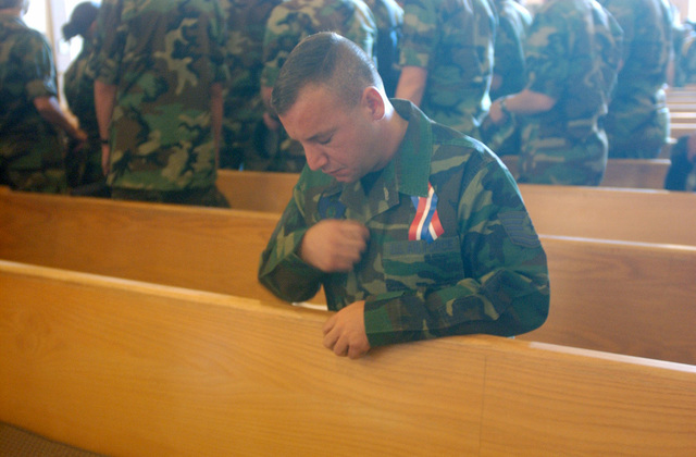 Sitting in a pew, US Air Force (USAF), Technical Sergeant (TSGT) Vincent Travali holds back much emotion as he says a final prayer at the end of the Remembrance Service at the Vandenberg Air Force Base (AFB), California, chapel, honoring the victims of September 11, 2001