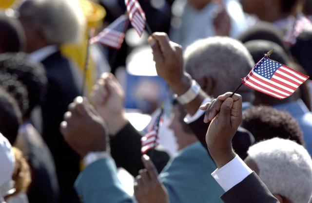 Spectators wave small American Flag to show their support while attending the 9/11 Memorial Service held at the Pentagon, in Washington, District of Columbia (DC)