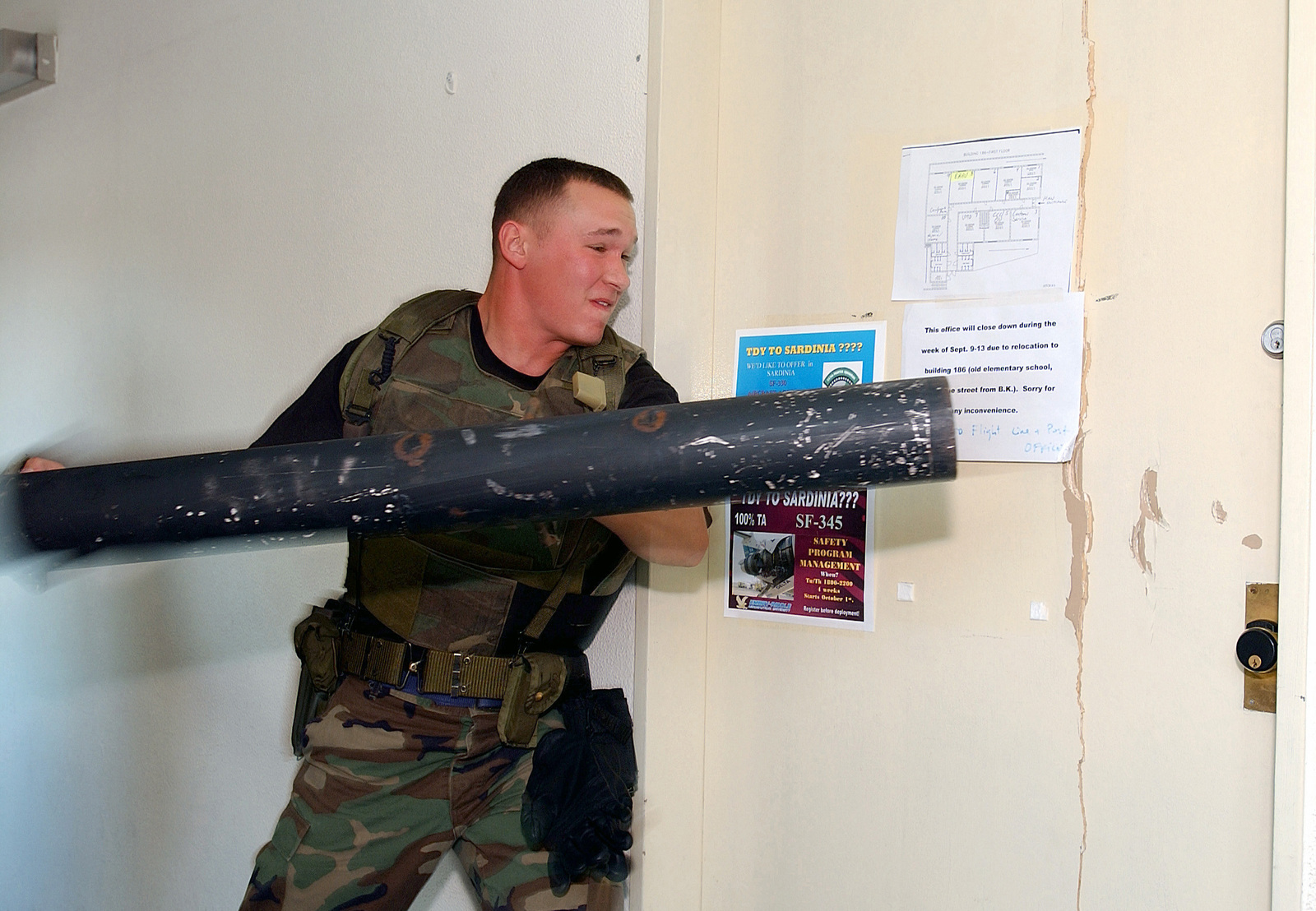 US Air Force (USAF) AIRMAN (AMN) Jarrod Getz, with the 31st Security Forces Squadron (SFS), at Aviano Air Base (AB), Italy, rams a door open during his realistic breach training