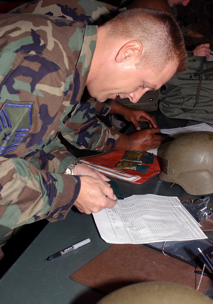 US Air Force (USAF) MASTER Sergeant (MSGT) David P. Moore, 52nd Mission Support Squadron (MSS), inspects a decontamination kit issued at the mobility bag issue point on September 18th, 2002
