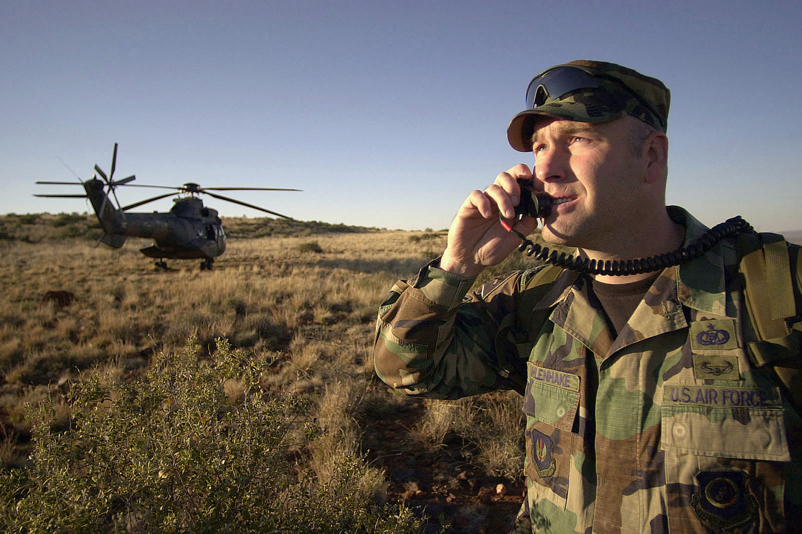 US Air Force (USAF) Technical Sergeant (TSGT) John Uhlenhake, 3 Air Force, Royal Air Force (RAF) Base Mildenhall, England, establishes communications with a B-1 Lancer bomber at the Lothala Range, Northern Province, Army Battle School, near Waterkloof, Air Force Base (AFB), Pretoria, South Africa