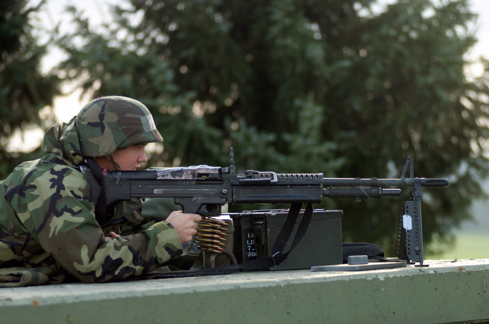 At his post, US Air Force (USAF) AIRMAN First Class (A1C) Nicholas Burtch, mans an M60 7.62MM Machine Gun on top of a pill box bunker, during the 52nd Fighter Wing's (FW) Operational Readiness Inspection (ORI), at Spangdahlem Air Base (AB), Germany