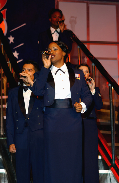 "A vocalist with the US Air Force (USAF) ""Tops in Blue"" entertainment troupe, USAF STAFF Sergeant (SSGT) Evelyn L. Bruce, Non-Commissioned Officer In Charge (NCOIC) of Patient Administration, at Incirlik Air Base (AB), Turkey, during a show entitled ""Spirit of America"" which highlights the ethnic diversity and contributions made by Americans, at Ramstein Air Base (AB), Germany"