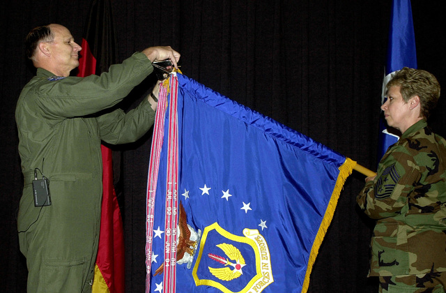 US Air Force (USAF) General (GEN) Gregory S. Martin, commander of USAF in Europe (USAFE), places an excellence streamer on the USAFE organizational flag, at the Ramstein Officers' Club