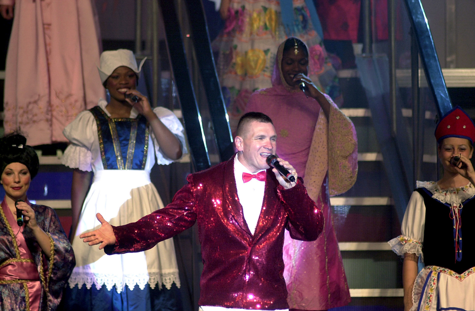 """US Air Force (USAF) MASTER Sergeant (MSGT) Bryan L. Langerud, 92nd Medical Support Squadron (MSS), Fairchild Air Force Base (AFB), Washington, performs """"Coming To America"""" at the """"Tops In Blue"""" concert, at Ramstein Air Base (AB), Germany"""