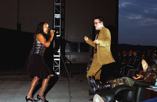 """US Air Force (USAF) STAFF Sergeant (SSGT) Evelyn L. Bruce, a vocalist with the USAF """"Tops in Blue"""" entertainment troupe performs a special song for USAF Captain (CAPT) John Gregory Martin, with a Computer Systems Squadron, during a performance at Ramstein Air Base (AB), Germany, a show entitled """"Spirit of America"""""""