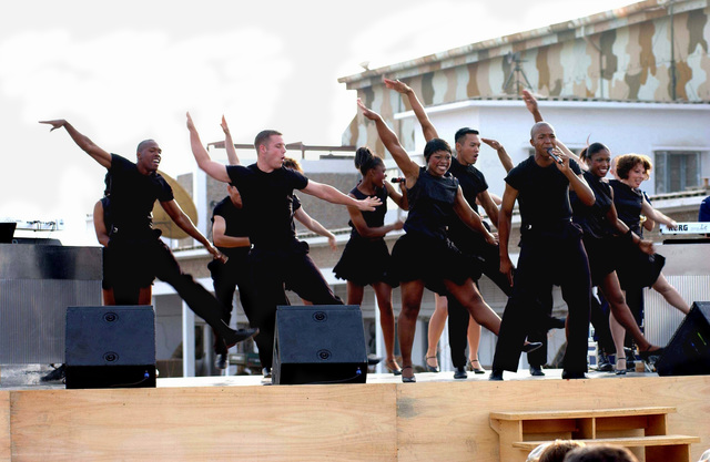 Members of the US Air Force (USAF) Premier entertainment showcase, Tops in Blue, perform live on stage for USAF personnel deployed with the 438th Air Expeditionary Group (AEG), at an undisclosed location in support of Operation ENDURING FREEDOM