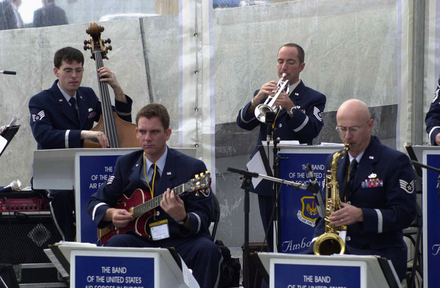 Members of the US Air Forces in Europe (USAFE) Band, perform during the Rededication Ceremony for the American Air Museum at Royal Air Force (RAF) Duxford, Cambridgeshire, United Kingdom (UK)