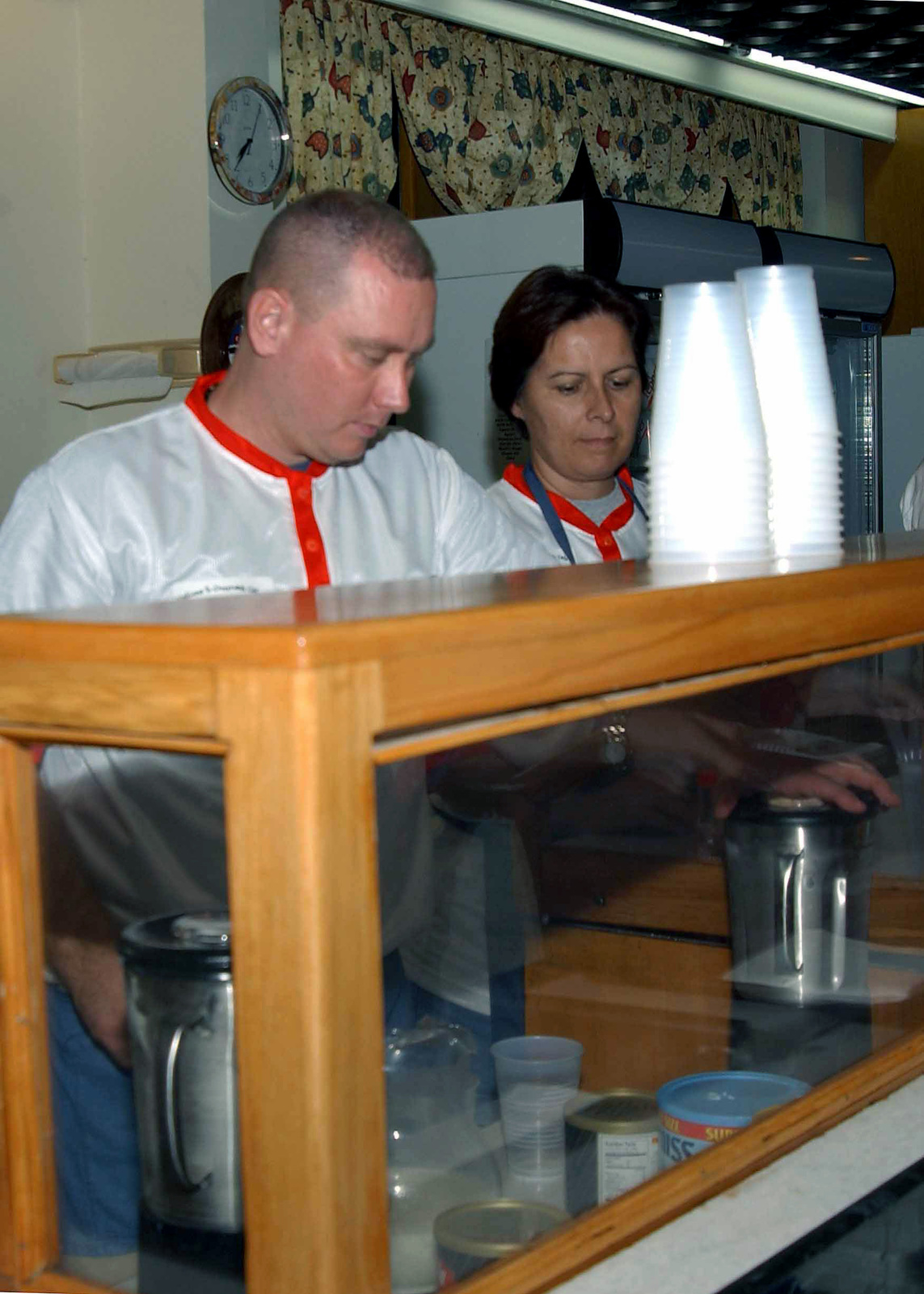 US Air Force (USAF) Technical Sergeant (TSGT) J. R. Foster, (foreground) gives USAF MASTER Sergeant (MSGT) Linda Valinho a lesson in frappacino making inside Crossroads Cafe, at Incirlik Air Base (AB), Turkey. The Crossroads is sponsored by Incirlik AB and deployed Chapels and is staffed completely by volunteers. It provides an alcohol free and smoke-free environment for base personnel and their dependents to meet, talk, play games or just watch television on Friday and Saturday nights
