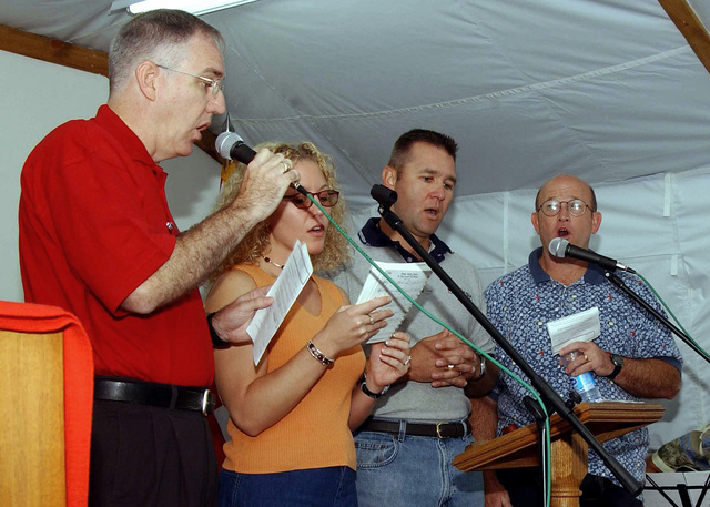 US Air Force (USAF) members of the deployed chapel praise team choir sing together during the Sunday Service at Incirlik Air Base (AB), Turkey. Pictured left-to-right, Lieutenant Colonel (LTC) Mike Shirley, USAF, Chaplain, Oklahoma (OK), Air National Guard (ANG); STAFF Sergeant (SSGT) Casey Cardoza, Hodja Village Services; SENIOR MASTER Sergeant (SMSGT) Jim Tyson, Hodja Village Services Superintendent, and CHIEF MASTER Sergeant (CMSGT) Henry Leopard, Combined Task Force (CTF), Operation NORTHERN WATCH
