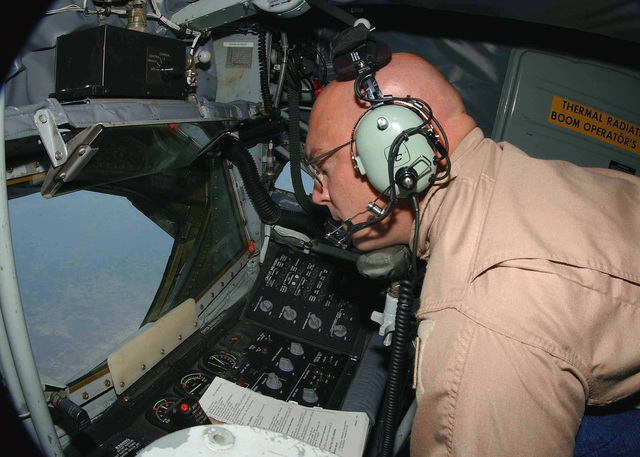 US Air Force (USAF) MASTER Sergeant (MSGT) Dan Smith, Boom Operator, 900th Expeditionary Air Refueling Squadron (EARS), man his position aboard a USAF KC-135R Stratotanker aircraft, during a refueling mission flow over Northern Iraq, in support of Operation NORTHERN WATCH