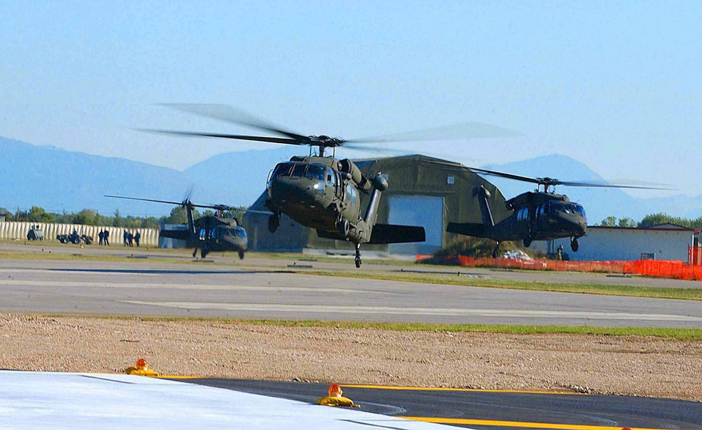 US Army (USA) UH-60 Black Hawk helicopters assigned to Bravo/Company, 5/158th Aviation Regiment, take off from the flight line at Aviano Air Base (AB), Italy, in preparation for a Joint Training Exercise with the Polish Armed Forces called Exercise VICTORY STRIKE III
