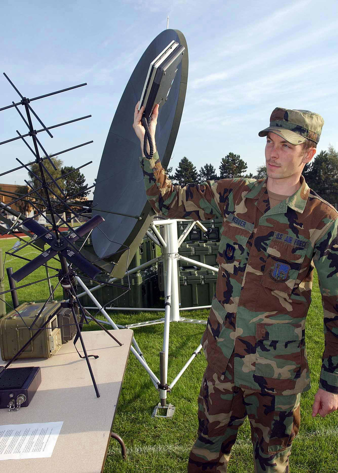 US Air Force (USAF) SENIOR AIRMAN (SRA) Stephen Webber, 48th Communications Squadron (CS), 48th Fighter Wing (FW), holds up an INMARSAT Communications display during the 48th Mission Support Group (MSG) Commander's Call being held at Royal Air Force (RAF) Lakenheath, United Kingdom (UK)