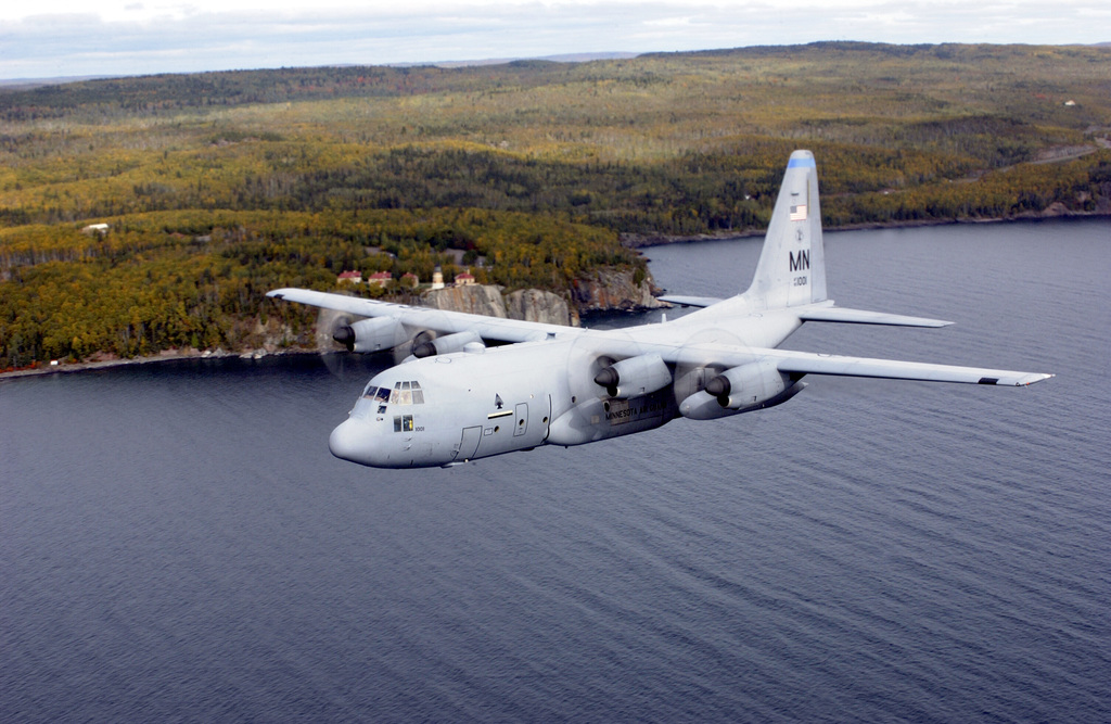 A US Air Force (USAF) Minnesota (MN) Air National Guard (ANG) C-130H3 Hercules aircraft assigned to the 133rd Airlift Wing, flies past the Split Rock Lighthouse, located on the shore of Lake Superior, MN