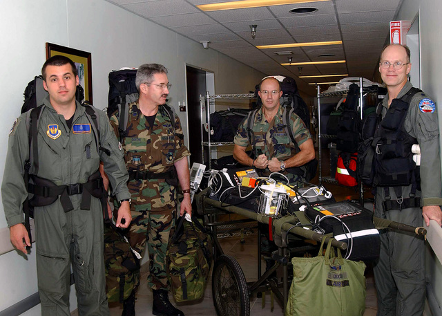 US Air Force (USAF) assigned to the 10th Expeditionary Medical Squadron (EMS), Combat Search and Rescue (CSR) Unit, display the equipment they carry to the field to provide on-the-spot medical services, while deployed at Incirlik Air Base (AB), Turkey, in support of Combined Task Force (CTF), Operation NORTHERN WATCH. Pictured left-to-right, USAF STAFF Sergeant (SSGT) Scott Humphries, USAF Lieutenant Colonel (LTC) Robert Dixon, USAF LTC Jerry Limoge, and USAF LTC Jeff Bodin
