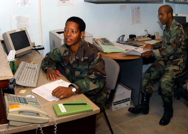 US Air Force (USAF) Captain (CPT) Gennifer Washington (left), Life Skills Social Worker, and USAF STAFF Sergeant (SSGT), Patrick Lewis, Life Skills Technician, both assigned to the 39th Medical Group (MDG), 10th Expeditionary Medical Squadron (EMS), tends to the mental health needs of base personnel at the Life Skills Clinic, while deployed at Incirlik Air Base (AB), Turkey, in support of Combined Task Force (CTF), Operation NORTHERN WATCH