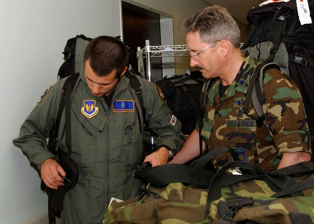 US Air Force (USAF) STAFF Sergeant (SSGT) Scott Humphries (left) gets assistance with his gear from USAF Lieutenant Colonel (LTC) Robert Dixon inside the 39th Medical Group (MGD) Hospital at Incirlik Air Base (AB), Turkey. Both Airmen are assigned with the 10th Expeditionary Medical Squadron (EMS), Combat Search and Rescue (CSR) Unit in support of Combined Task Force (CTF), Operation NORTHERN WATCH