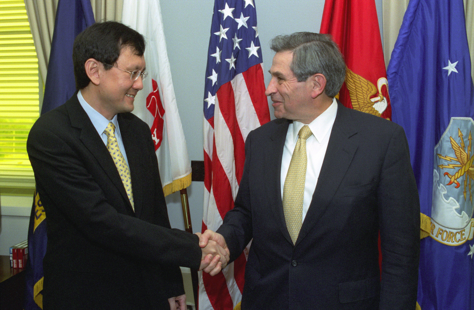 Raymond Lim (left), Minister of State for Foreign Affairs of Singapore, and the Deputy Secretary of Defense Paul Wolfowitz (right), shake hands at the Pentagon, Washington, D.C., on Oct. 4, 2002.  OSD Package No. A07D-00658 (DOD PHOTO by Robert D. Ward) (Released)