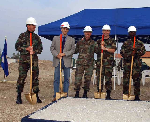 US Air Force (USAF) and Civilian Honorees pose for a group photograph during the Groundbreaking Ceremony for the new Integrated Communications Complex (ICC), at Aviano Air Base (AB), Italy. Pictured left-to-right, USAF Colonel (COL) Joseph Abbott, 31st Mission Support Group (MSG); Mr. Daniel Pelletier, Program Manager for Cooperative Muratori Riuniti (CMR); US Navy (USN) Commander David Kelley, Resident Officer In Charge Of Construction (ROICC); USAF COL David Warner, Communications and Information, Headquarters, US Air Forces in Europe (USAFE); and USAF AIRMAN First Class (A1C) Rashad Cousins, representing USAF Lieutenant Colonel (LTC) Kathleen Harrington,...