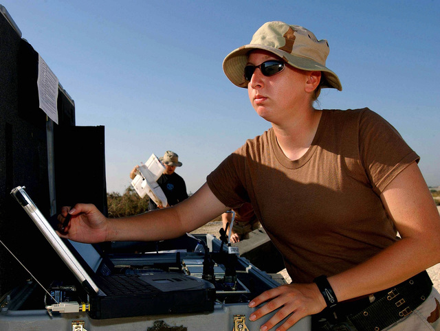 US Air Force (USAF) SENIOR AIRMAN (SRA) Amy Hodges, Airborne Surveillance Radar System Technician assigned to the 438th Expeditionary Force Protection Squadron (EFPS) waits for final Global Positioning Systems (GPS) data before launching a US Air Force (USAF) Desert Hawk Force Protection Airborne Surveillance (FPAS), Unmanned Aerial Vehicle (UAV), while deployed at forward location during Operation ENDURING FREEDOM