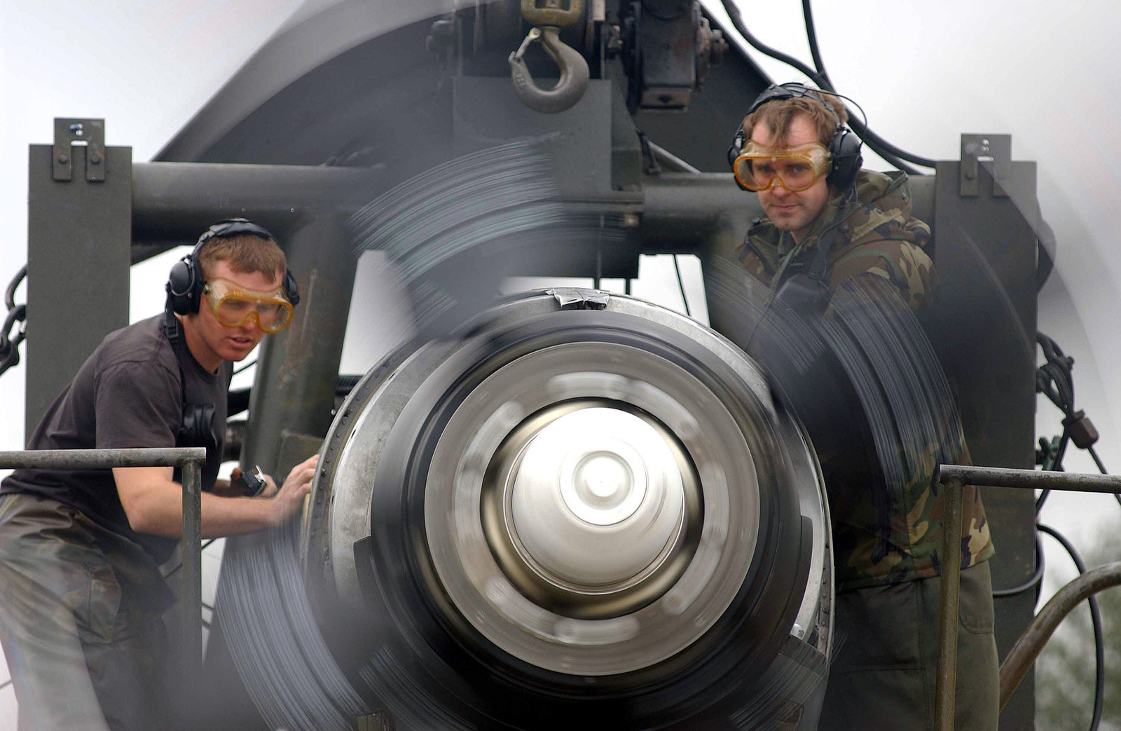 US Air Force (USAF) SENIOR AIRMAN (SRA) James Bolstad (left) and USAF STAFF Sergeant (SSGT) James McNee, both assigned to the 86th Maintenance Squadron (MXS), conduct visual operation checks during an aircraft engine run up, being conducted at Ramstein Air Base (AB), Germany