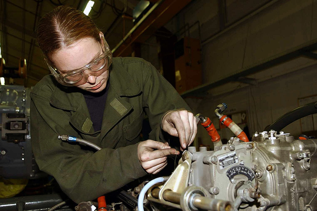 US Air Force (USAF) SENIOR AIRMAN (SRA) Rachel Roy, 86th Maintenance Squadron (MXS), installs a fuel control in an aircraft engine, inside the maintenance shop at Ramstein Air Base (AB), Germany