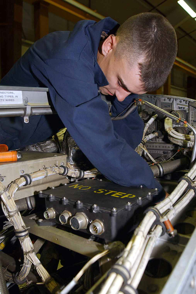 US Air Force (USAF) SENIOR AIRMAN (SRA) Timothy Roberts, 86th Maintenance Squadron (MXS), performs maintenance on an aircraft engine, inside the maintenance shop at Ramstein Air Base (AB), Germany