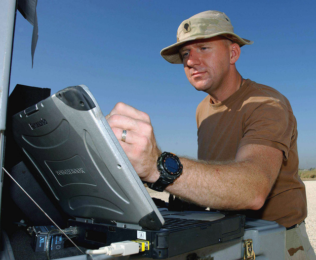 US Army (USA) SPECIALIST (SPC) Dan Sawicki, 972nd Military Police (MP) Company, operates the controls of a US Air Force (USAF) Desert Hawk Force Protection Airborne Surveillance (FPAS), Unmanned Aerial Vehicle (UAV), while deployed at forward location during Operation ENDURING FREEDOM