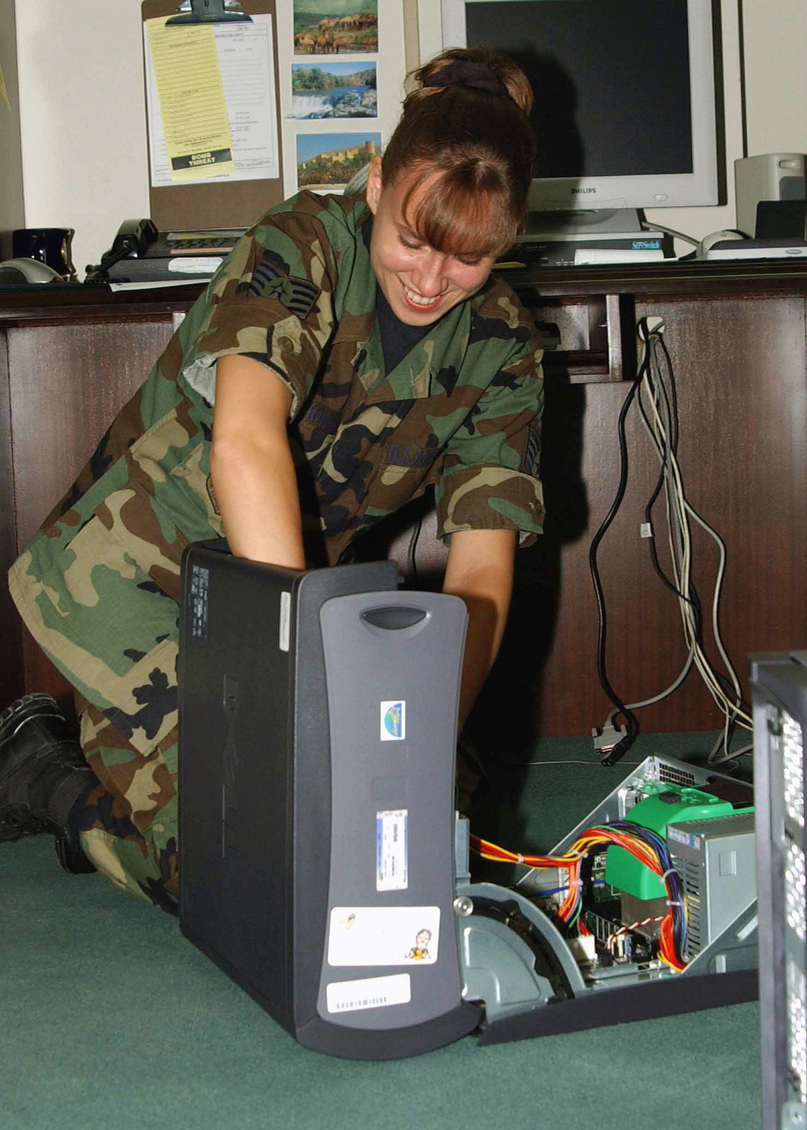 US Air Force (USAF) STAFF Sergeant (SSGT) Cathe Rynkowski, Information Manager, Combined Task Force (CTF) Headquarters, Incirlik Air Base (AB), Turkey, configures a new computer while deployed in support of Operation NORTHERN WATCH