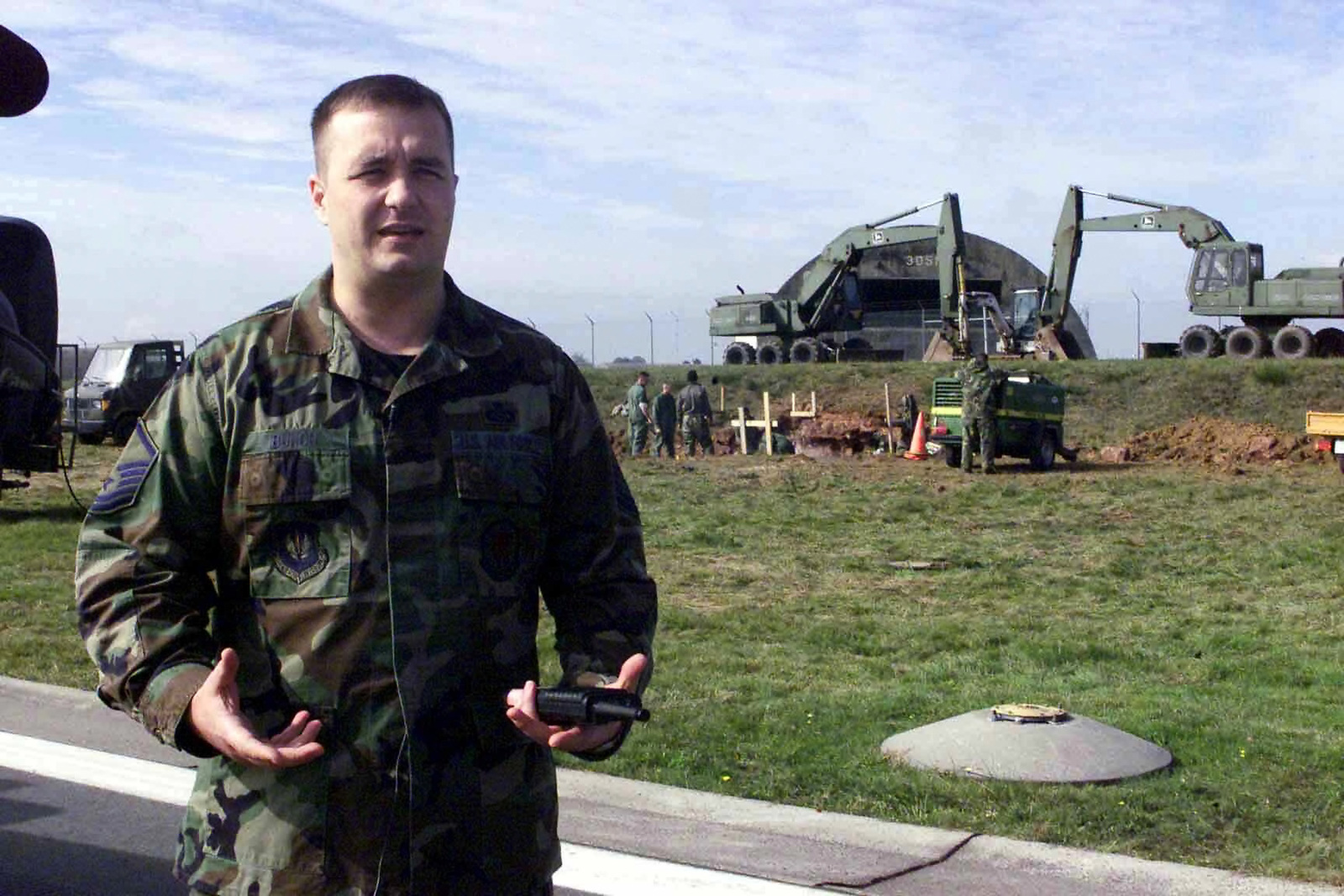 US Air Force (USAF) MASTER Sergeant (MSGT) Anthony Bunch, Airfield Manger, 52nd Operations Support Squadron (OSS) supervises a flight line modification project underway at Spangdahlem Air Base (AB), Germany
