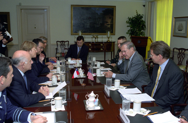 The Honorable Donald H. Rumsfeld (2nd from right), Secretary of Defense, and staff, conduct talks with Michelle Bachelet (3rd from left), Minister of Defense, Republic of Chile, and staff, at the Pentagon, Washington, D.C., on Oct. 8, 2002. OSD Package No. A07D-00662 (DOD PHOTO by Robert D. Ward) (Released)