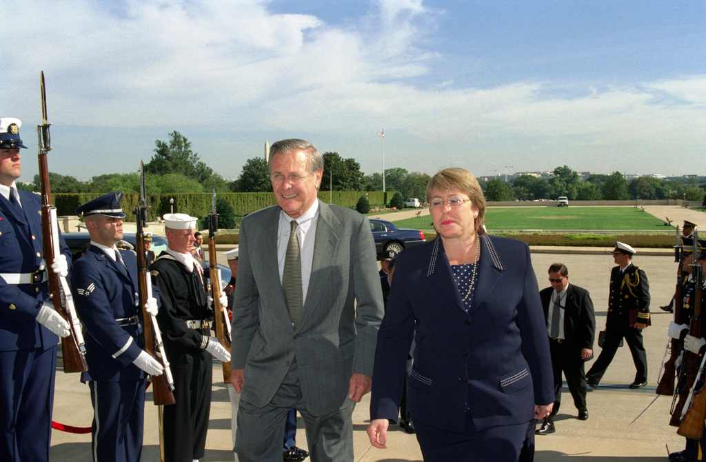 The Honorable Donald H. Rumsfeld (left), U.S. Secretary of Defense, escorts Michelle Bachelet (right), Minister of Defense, Republic of Chile, through an Honor Cordon at the River Entrance to the Pentagon, Washington, D.C., on Oct. 8, 2002. OSD Package No. A07D-00662 (DOD PHOTO by Robert D. Ward) (Released)