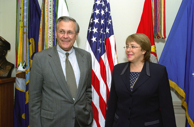 The Honorable Secretary of Defense Donald H. Rumsfeld (left), and Michelle Bachelet (right), Minister of Defense, Republic of Chile, pose for a photograph the Pentagon, Washington, D.C., on Oct. 8, 2002. OSD Package No. A07D-00662 (DOD PHOTO by Robert D. Ward) (Released)