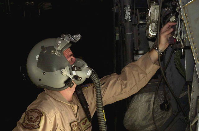 US Air Force (USAF) AIRMAN First Class (A1C) Cory Eubanks, C-130 Hercules aircraft Loadmaster, 777th Expeditionary Airlift Squadron (EAS), checks his life support equipment onboard the aircraft, before departing for a mission at a forward deployed location in support of Operation ENDURING FREEDOM