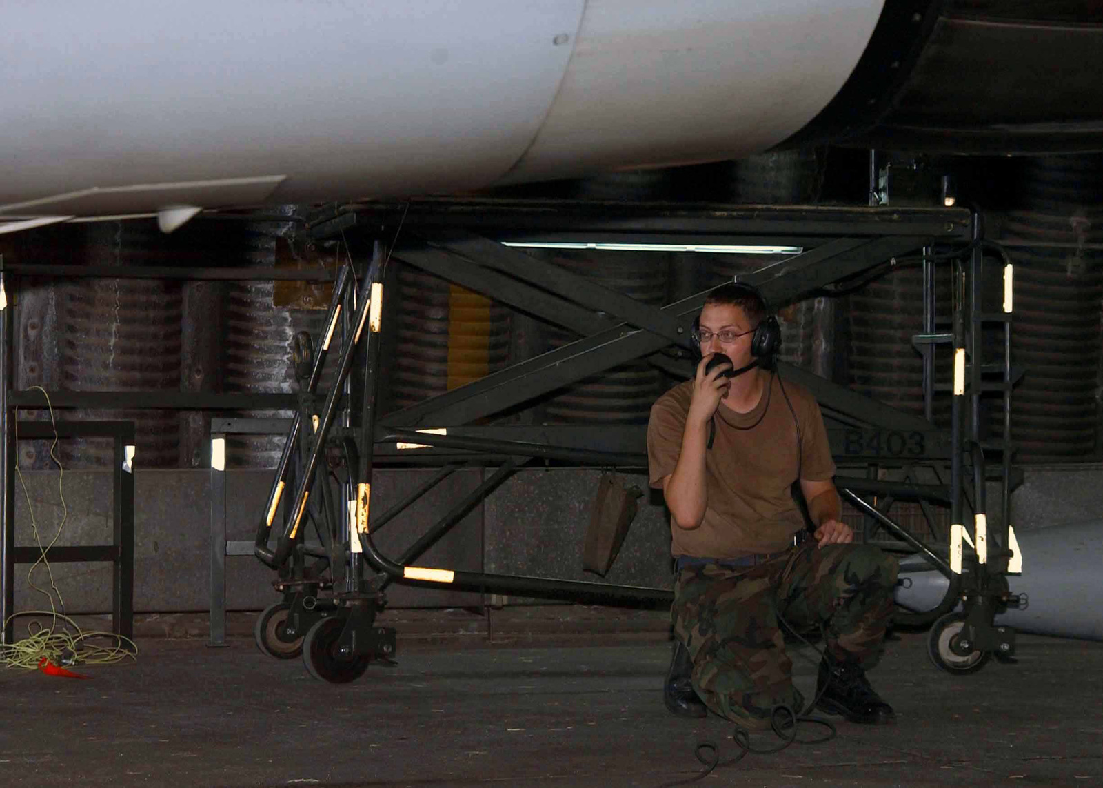 US Air Force (USAF) SENIOR AIRMAN (SRA) Bradley Taylor, 78th Expeditionary Fighter Squadron (EFS) talks into the communication system, as he conducts aircraft maintenance at Incirlik Air Base (AB), Turkey, while deployed in support of Combined Task Force (CTF), Operation NORTHERN WATCH
