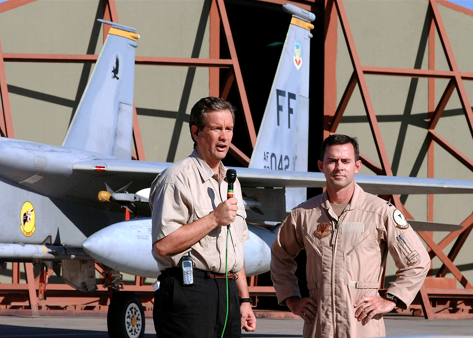 With a US Air Force (USAF) F-15C Eagle aircraft set as the backdrop, Cable News Network (CNN) senior Pentagon correspondent Jamie McIntyre (left), conducts a live interview with USAF Captain (CPT) Patrick Driscoll, a Pilot assigned to the 25th Expeditionary Fighter Squadron (EFS), during CNNs the first ever live satellite feed from Incirlik Air Base (AB), Turkey, conducted during Combined Task Force (CTF), Operation NORTHERN WATCH