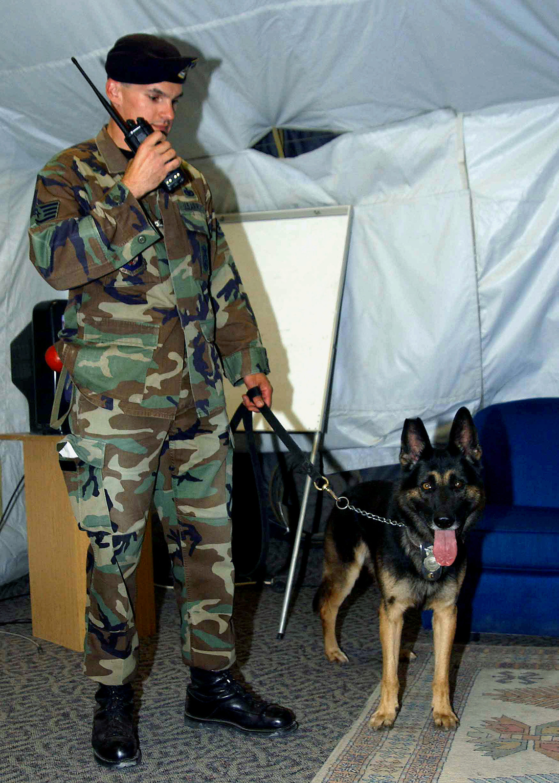 US Air Force (USAF) STAFF Sergeant (SSGT) Len Arsenault Military Working Dog Handler, 39th Security Forces Squadron (SFS), prepares conduct a routine search for explosives, with his working dog Brosky inside the morale tent at Incirlik Air Base (AB), Turkey, while deployed in support of Operation NORTHERN WATCH