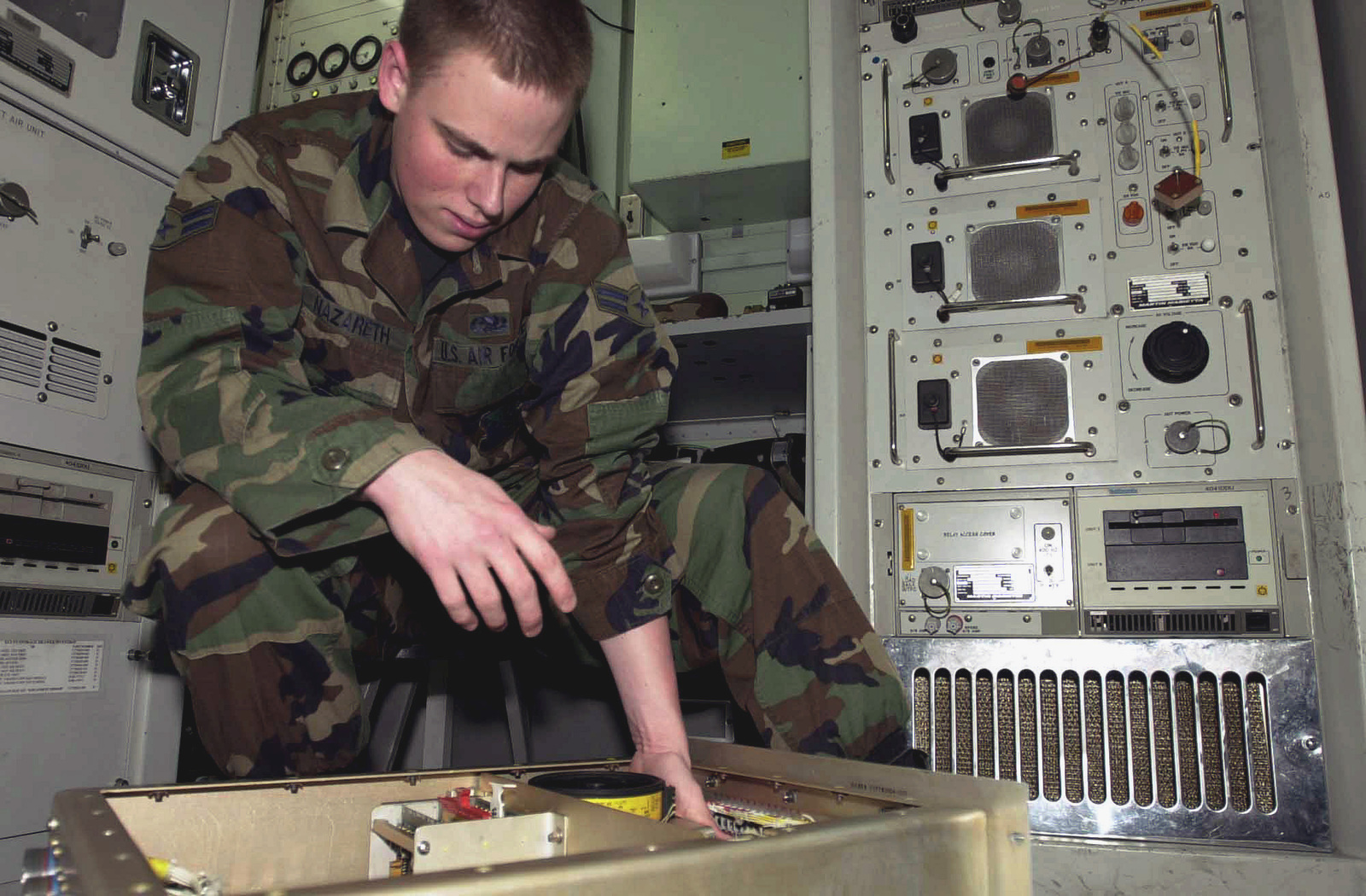 US Air Force (USAF) AIRMAN First Class (A1C) Jason Nazareth, Avionics Sensor Technician, 31st Maintenance Squadron replaces an Alternating Current (AC) sensor relay in the Environmental Control Unit Test Chamber, at Aviano Air Base (AB), Italy