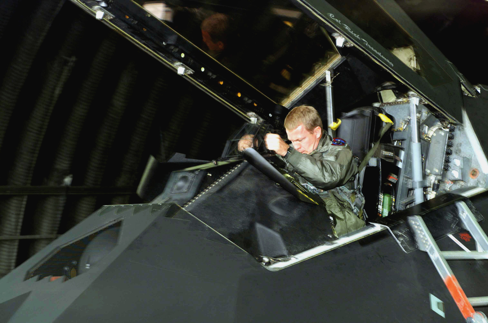 US Air Force (USAF) Major (MAJ) James Johnson, F-117A Nighthawk aircraft Pilot assigned to the 9th Fighter Squadron (FS), climbs into the cockpit of his aircraft for a training mission at Spangdahlem Air Base (AB), Germany