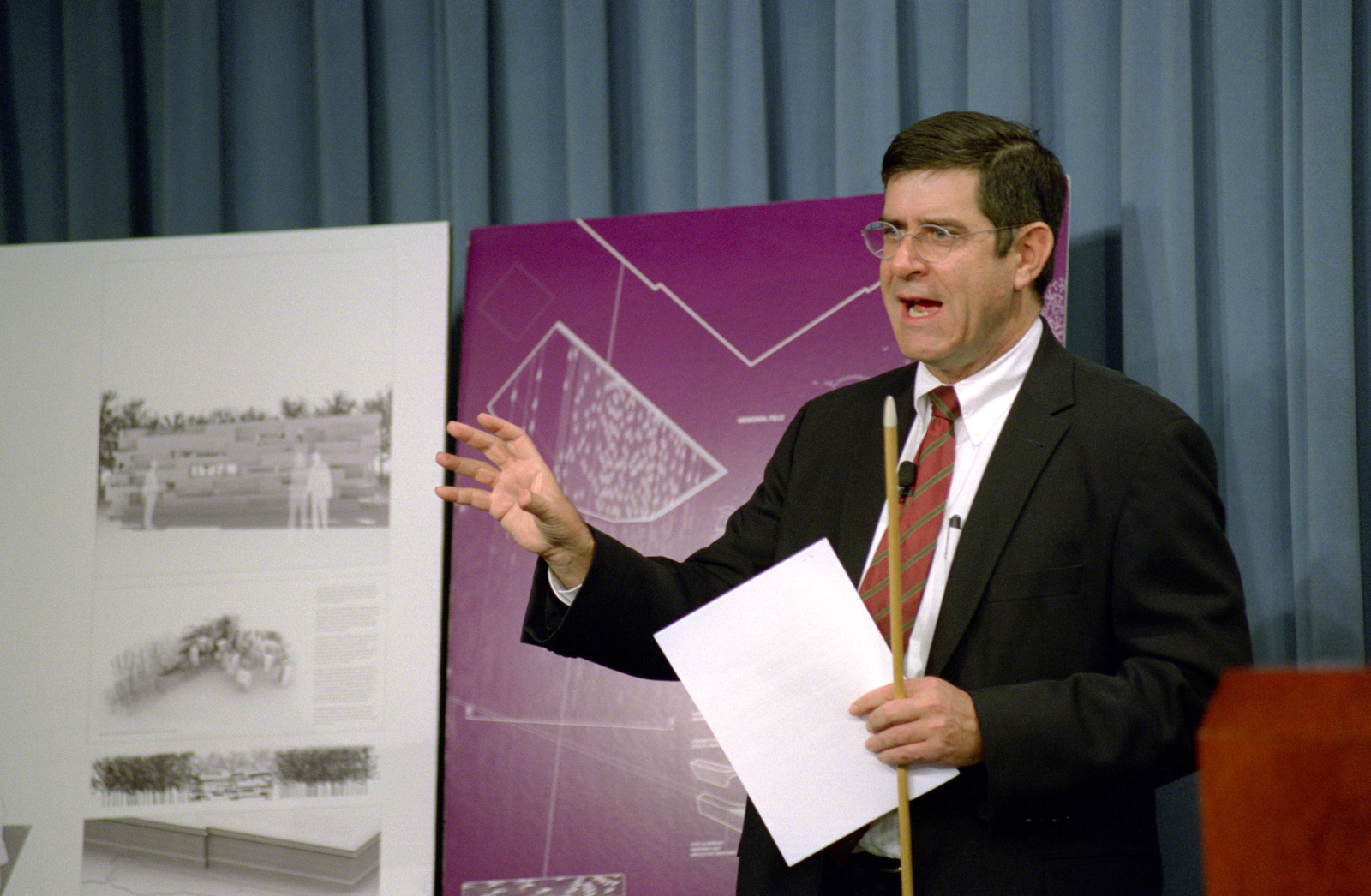 Terry Riley, the New York Museum of Modern Art CHIEF Curator of Design and Architecture, shows the drawings of the finalists of the Pentagon Memorial Design Competition at the Pentagon, Washington, D.C., on Oct. 17, 2005. OSD Package No. 00670 (DOD PHOTO by Robert D. Ward) (Released)