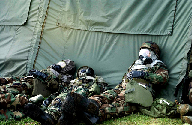 US Air Force (USAF) Airmen assigned to the 11th Wing (WG), dressed in Mission-Oriented Protective Posture response level 4 (MOPP-4) gear participate in chemical warfare training in preparation for the upcoming Aerospace Expeditionary Force 9 (AEF-9) deployment, as part of Exercise Sabertooth 2002 being held at Bolling Air Force Base (AFB) Washington, District of Columbia (DC)