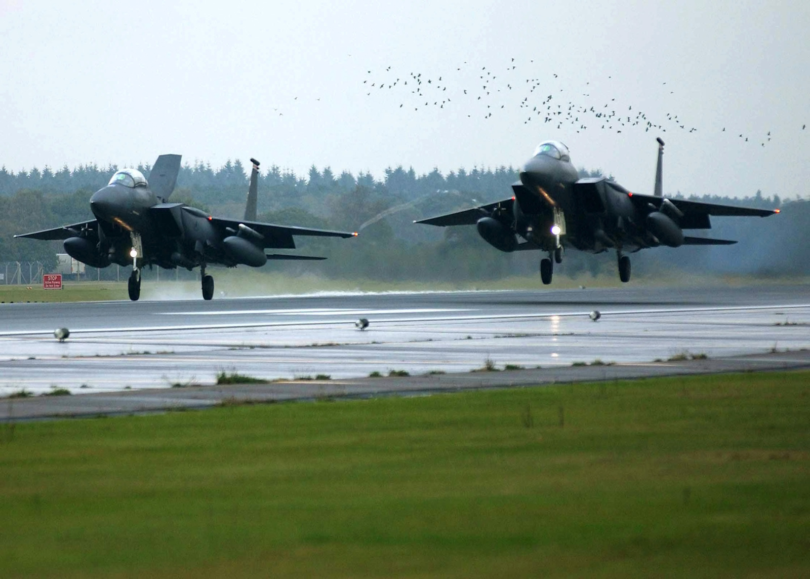 A US Air Force (USAF) 494th Fighter Squadron (FS) F-15E Strike Eagles from the 48th Fighter Wing (FW) return home to the Royal Air Force (RAF) Lakenheath, England, runaway after completing a sortie